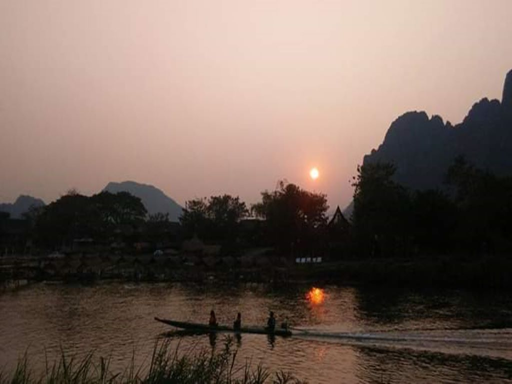 Sunset reflecting over the Nam Song River.jpg